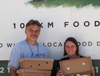 Steve Venhuizen, driver or 100 Km Foods Inc. picks up the first order at the Grey County Chefs' Forum Flesherton Food Hub from Cindy Phillips. Mushrooms from Northern Woods Mushrooms in Markdale are headed to restaurants in the GTA.