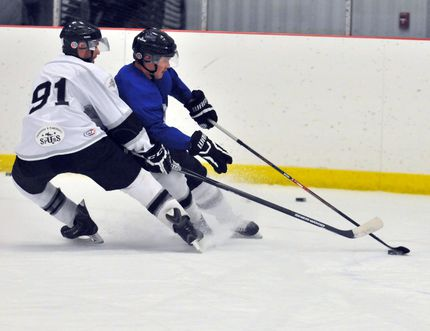 Corey Wamsteeker, right, tries to take the puck around Parker McPhillamey, during tryout camp for the County of Grande Prairie JDA Kings on Sunday, September 7. Wamsteeker will be a key offensive contributor to the Kings this season.Logan Clow/Daily Herald-Tribune