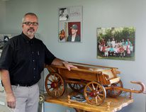 Cor Lodder's Carman office is full of keepsakes, from the third scale replica of the wagons his grandfather, Case Walinga, built in the Netherlands to photographs of his family. (EMILY DISTEFANO/Prairie Farmer)