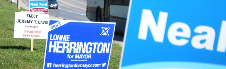 Election signs like the one pictured here on College Street East, can be found on street corners across the city. Public complaints about some of the signs location have prompt city officials to warn several candidates about the improper placement of signs. Jason Miller/The Intelligencer.