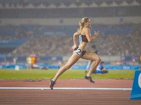 Lexi Aitken from Clinton competing in the women's 400-meter hurdles at the 2014 Summer Youth Olympic Games in Nanjing, China last month.