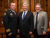 Paul Boissonneault is congratulated by Prime Minister Stephen Harper and Brant MP Phil McColeman on being elected president of the Canadian Association of Fire Chiefs. (Photo by Deb Ransom)