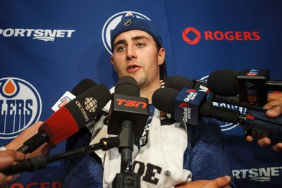 Edmonton forward Jordan Eberle speaks with reporters on the first day of the Edmonton Oilers training camp at Rexall Place in Edmonton, Alta., on Thursday, Sept. 18, 2014. Players went through medical and physical testing. Ian Kucerak/Edmonton Sun/ QMI Agency
