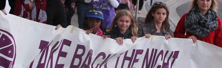 A group of about 100 people marched through the streets of downtown Sarnia Thursday for the community's 21st annual Take Back the Night demonstration. Holding the banner are Kayla Collier, left, Tayleena Sullivan, Gabrielle Smith, Adelaide Smith, Jenna Regier, and Gary Parsons (not pictured). TYLER KULA/ THE OBSERVER/ QMI AGENCY