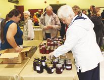 The final MCC Relief Auction in Morris Saturday, Sept. 13 drew thousands of people to the Stampede Grounds looking for a bargain and a chance to sample plenty of tasty foods. (DON RADFORD/Red River Valley Echo)