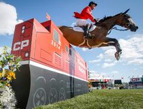 Getting the camera in the right spot is half the battle. Lyle Aspinall of the Calgary Sun positioned his camera at a low-angle to work remotely just in time for Ian Millar's ride at the Masters tournament at Spruce Meadows. Millar won the half-million-dollar pot in the show-jumping facility's annual signature event last Sunday.
