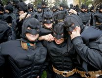A throng of Batman-costumed Nexen workers gather outside of the Nexen tower in downtown Calgary, Alta., on Thursday, Sept. 18, 2014. (Lyle Aspinall/QMI Agency)
