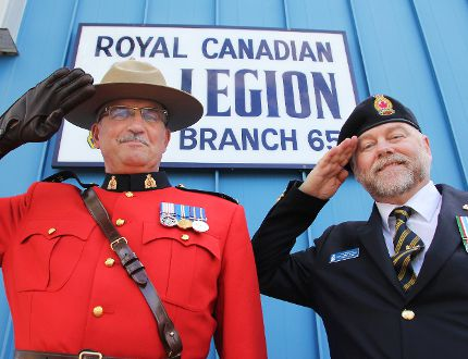 RCMP Insp. Ron Russell salutes with Royal Canadian Legion Branch 65 vice-president Daniel Boyse in front of the legion on Tuesday. The branch is holding Legion Week Sept. 20-27. (Svjetlana Mlinarevic/The Graphic/Herald Leader)