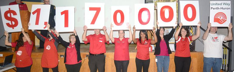 Members of the United Way Perth-Huron unveil the organization's 2014 campaign goal at a kickoff lunch Friday at the Kiwanis Community Centre. (SCOTT WISHART, The Beacon Herald)