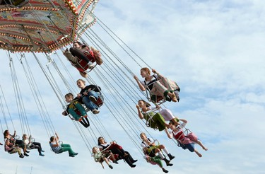 Visitors ride a merry-go-round during the opening day of the 181st Oktoberfest in Munich September 20, 2014. Millions of beer drinkers from around the world will come to the Bavarian capital over the next two weeks for the Oktoberfest, which starts today and runs until October 5.  REUTERS/Lukas Barth