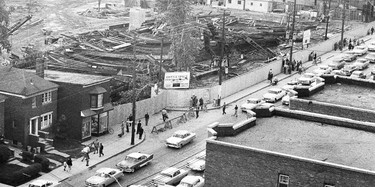 """If I remember correctly (after all it was more than a half-century ago) I took this """"historic"""" photo with my roll film camera from the roof of superintendent Abe Hay's three-storey apartment building that stood for years at the northeast corner of the Eglinton and Redpath Aves. intersection on Sept. 16, 1958. Visible in the background of this rather grainy black and white view (digital stuff was decades in the future and as a student I just couldn't afford colour film) is the nearly 2,000 tons worth of collapsed steel that had formed the frame of the new Union Carbide Building that was under construction on a site along the south side of Eglinton Ave. west of Redpath."""
