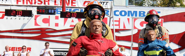 Competitors are cheered on as they rescue their dummies during the final stretch of the Fire Combat Challenge in the Downtown Chatham Centre Parking lot on Saturday. It was the first time that FireFest Chatham-Kent hosted the competition. TREVOR TERFLOTH/trevor.terfloth@sunmedia.ca