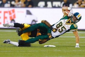 Eskimos' Nate Coehoorn catches a pass against Tiger-Cats' Courtney Stephen in Hamilton last night. The Ticats are now 3-0 in their new home. (Mark Blinch/Reuters)