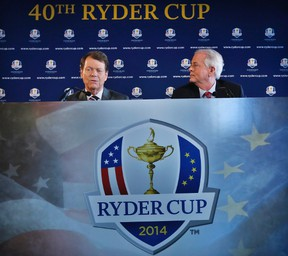 File photograph shows Golfer Tom Watson (L) and PGA of America president Ted Bishop speaking to the press after being introduced as Ryder Cup captain in New York, December 13, 2012. (REUTERS/Brendan McDermid/Files)
