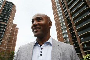 Andray Domise goes door to door in Ward 2 in Etobicoke. He is running for city councillor against Rob Ford. (Stan Behal/Toronto Sun)