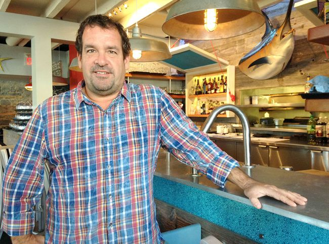 Tim Pater is the owner of four restaurants in Kingston that are participating in a customer loyalty program that lets them exchange points for rewards. He believes it helps small businesses compete against the big box stores. (Michael Lea/The Whig-Standard)