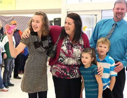Gino Donato/The Sudbury Star Thirteen-year-old Cassandra Degn waves at friends as she arrives with her family, mother Julie, father Michael and brother and sister Logan and Alexa at the Winners store in New Sudbury on Sunday afternoon ,where she received her dream of going to Walt Disney World from the Sunshine Foundation of Canada.