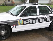 A Winnipeg Police cruiser sits outside a house in Winnipeg, Man. in this file photo taken Sunday June 23, 2013. (BRIAN DONOGH/QMI AGENCY)