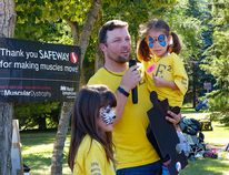 Acting as the ambassador for the Muscular Dystrophy Walk in Edmonton on Sept. 6 Emily Wirth (right) attended the event with her dad Merv and big sister Trinity.