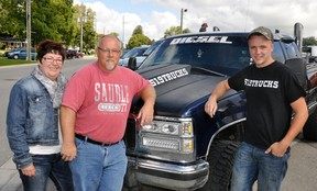 Jody and Rob Brown (left), of Dublin, pose with James Hope, of Orangeville and 519Trucks Facebook site prior to a memorial ride Sunday, Sept. 21 for the Brown's late son Travis. More than 280 trucks congregated in Mitchell and drove to Dublin for a fundraising barbeque for the Dublin ball park. ANDY BADER/MITCHELL ADVOCATE