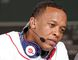 Recording artist Dr. Dre wears a pair of Beats headphones as he attends MLB's 2010 season opener to watch the reigning World Series Champions New York Yankees take on the Boston Red Sox at Fenway Park in Boston, Massachusetts in this file photo taken April 4, 2010. REUTERS/Adam Hunger/Files