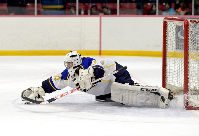 Kirkland Lake Gold Miners goalie Devon Debastos, shown here pouncing on a loose puck during a game against the Abitibi Eskimos at the McIntyre Arena on Sept. 19, is tied with Eskimos goalie Braddock Baalerud for the best goals against average in the NOJHL — 1.00 — following the first three weeks of the schedule.