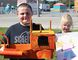 Langton Public School students Bobby Graham and Hannah Wall show off their entries into the Langton Fair in front of the fairgrounds on Tuesday. The fairgrounds will be abuzz during the one-day event on Wednesday. (SARAH DOKTOR Simcoe Reformer)