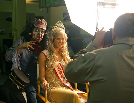 Dressed as St. Thomas Tom Zombie Festival's first Tom Zombie, Hamilton actor John Migliore menaces St. Thomas beauty queen Kristen McCord after Migliore was introduced at a photo op. File photo