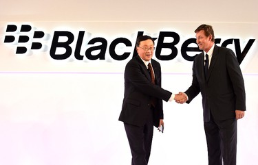 BlackBerry chief executive John Chen (L) welcomes Wayne Gretzky (R) as a guest of the official launch event for the BlackBerry Passport smartphone event in Toronto, Sept. 24, 2014. REUTERS/Aaron Harris