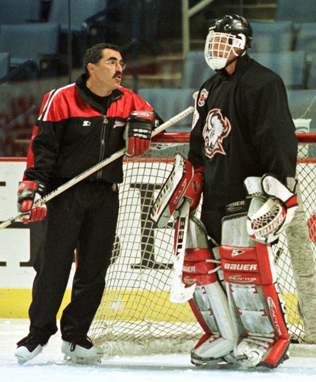 Jim Corsi, a long-time NHL goalie coach seen here in 1999 with ex-Buffalo Sabres netminder Dominik Hasek, has an advanced stat named after him. (Reuters)