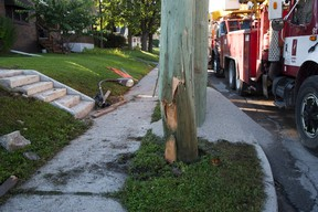 London Hydro crews were busy replacing a pole on Wellington Rd. at Whetter Rd. that was damaged when it was struck by a vehicle in early this morning in London. A passenger in the vehicle was ejected and killed. DEREK RUTTAN/ The London Free Press /QMI AGENCY