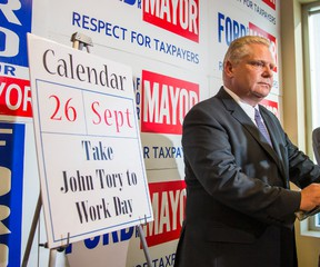 """Doug Ford declares Friday """"Take John Tory to Work Day"""" during a press conference at his campaign headquarters Wednesday, Sept. 24, 2014. (Ernest Doroszuk/Toronto Sun)"""