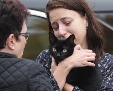 Jinx, a female cat, was the last of several animals rescued from the ruins of a home that had exploded on Apple Lane in Winnipeg.  Jinx is pictured here with her owner, Serena.    Wednesday, September 24, 2014.  Chris Procaylo/Winnipeg Sun/QMI Agency