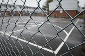 A chain link fence encloses the basketball court in a public housing complex on Millbank Dr. and Southdale Rd. in London (File photo)