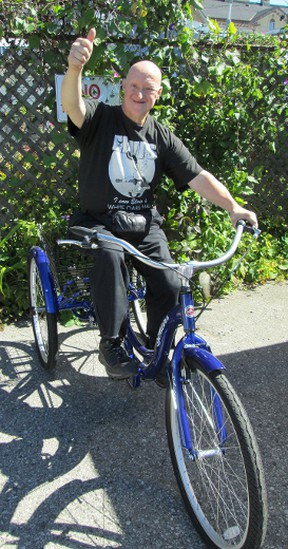 Ross Matlack and his new wheels, bought by an anonymous benefactor to replace a stolen machine. Contributed