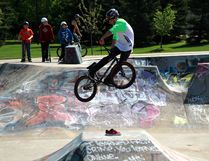 Brendon Mitchell, 17, jumps over a pair of red kicks in a competition in an attempt to win them during a competition earlier this summer at the Muskoseepi Park skatepark. Bikers, skaters, and scooter riders are working with the city to upgrade the skatepark after the Grande Prairie Skatepark Association met with the city earlier this month. Laura Booth/DHT FILE