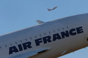 A plane of French regional airline unit Hop! takes off behind the retired Concorde number 5  at the Charles de Gaulle International Airport in Roissy, near Paris, in this file photo taken September 26, 2014. REUTERS/Jacky Naegelen