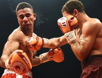 "Sports photography is about timing. ""You cannot simply react to the action, you've got to anticipate it,"" says Sebastien St-Jean of the QMI Agency Montreal bureau. The photographer's timing was as good as boxer Will Madera's, whose punch in lightweight action in Montreal on Tuesday was captured perfectly by St-Jean."