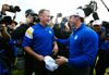 Team Europe golfer Jamie Donaldson (L) celebrates with teammate Rory McIlroy after winning his match against U.S. player Keegan Bradley to retain the Ryder Cup for Europe on the 15th green during the 40th Ryder Cup at Gleneagles in Scotland September 28, 2014. (REUTERS/Eddie Keogh)