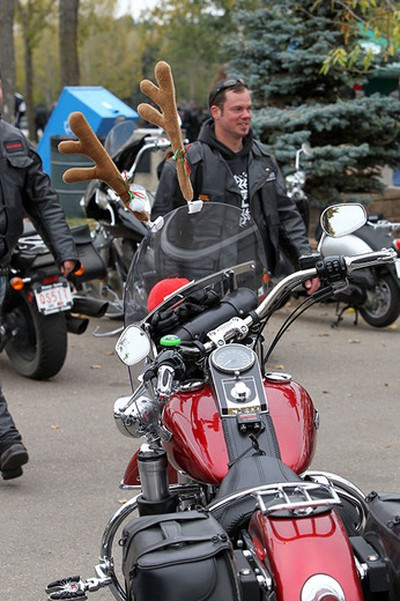 A biker walks past a motorcycle with antlers at the end of the the 31th annual Edmonton Motorcycle Toy Run at Hawrelak Park in Edmonton, Alberta on September 28, 2014. Perry Mah/Edmonton Sun/QMI Agency