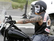 A motorcycle rider wearing Hells Angels' Alberta colours is stopped at a traffic light in this file photo. (JIM WELLS/QMI Agency Files)
