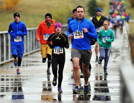 Mairen Lawson, left and Josef Labuschagne lead a pack of runners during the Grande Prairie Run/Walk Club's Roots and Ruts Trail Race near South Bear Creek, on Friday. 259 participants laced up for the race. Logan Clow/Daily Herald-tribune