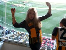 Model strips, allegedly fights cops at Aussie rules game