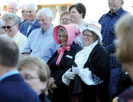 Onlookers, including Lorraine Reoch and Elaine Farley in the pink and white bonnets respectively, share a moment during opening ceremonies at the British Home Child Day in Athens Saturday (NICK GARDINER/The Recorder and Times).