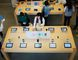 Customers look at Apple iPhone 5c and 5s at an Apple store in Beijing's Sanlitun area, Sept. 30, 2014. REUTERS/JASON LEE