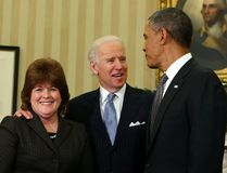 U.S. President Barack Obama, right, stands with U.S. Secret Service agent Julia Pierson, left, after she is sworn in as the first woman Director of the Secret Service by Vice President Joe Biden, centre, in the Oval Office of the White House in Washington in this March 27, 2013 file photo. (REUTERS/Larry Downing)