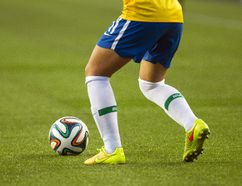 A Brazil player moves the ball across the artificial turf against China during the FIFA U-20 Women's World Cup play at Commonwealth Stadium in Edmonton, Aug. 5, 2014. (IAN KUCERAK/QMI Agency)