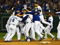 Royals rally in 12th inning to put down A's in crazy wild card game