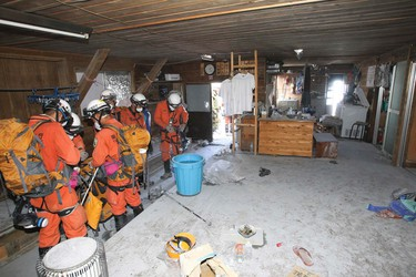 Firefighters prepare for rescue operations at a mountain lodge, near the peak of Mount Ontake, which straddles Nagano and Gifu prefectures, central Japan, in this handout photograph released by Tokyo Fire Department and taken September 28, 2014.   REUTERS/Tokyo Fire Department/Handout via Reuters