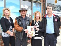 Ron Lindsay, second from the left, was the winner of a $2,500 travel voucher, courtesy of Hanover Travel, drawn at the final race of 2014. Pictured with Lindsay are, from the left, Wendy Hunsperger and Susan Hickling of Hanover Travel and Gord Dougan, general manager of Hanover Raceway.